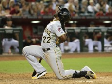 PHOENIX, AZ - AUGUST 02:  Andrew McCutchen #22 of the Pittsburgh Pirates reacts after being hit by a pitch from the Arizona Diamondbacks during the ninth inning of the MLB game at Chase Field on August 2, 2014 in Phoenix, Arizona. The Pirates defeated the Diamondbacks 8-3.  (Photo by Christian Petersen/Getty Images)