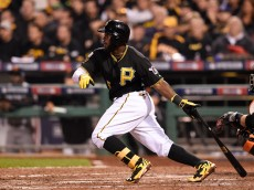 PITTSBURGH, PA - OCTOBER 01:  Josh Harrison #5 of the Pittsburgh Pirates hits a single in the sixth inning against the San Francisco Giants during the National League Wild Card game at PNC Park on October 1, 2014 in Pittsburgh, Pennsylvania.  (Photo by Jason Miller/Getty Images)