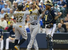 MILWAUKEE, WI - APRIL 12: Andrew McCutchen #22 of the Pittsburgh Pirates and Jordy Mercer #10 of the Pirates high-five after McCutchen's  three run home run in the fifth inning at Miller Park on April 12, 2015 in Milwaukee, Wisconsin.  (Photo by Jeffrey Phelps/Getty Images)
