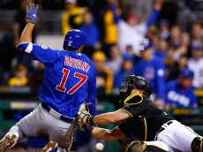 PITTSBURGH, PA - APRIL 20:  Kris Bryant #17 of the Chicago Cubs slides safely into home plate on an error by Francisco Cervelli #29 of the Pittsburgh Pirates during the game at PNC Park on April 20, 2015 in Pittsburgh, Pennsylvania.  (Photo by Jared Wickerham/Getty Images)