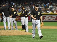 PHOENIX, AZ - APRIL 24:  Gerrit Cole #45 of the Pittsburgh Pirates walks into his dugout after coming out of the game in the seventh inning against the Arizona Diamondbacks at Chase Field on April 24, 2015 in Phoenix, Arizona. Pittsburgh won 4-1.  (Photo by Norm Hall/Getty Images)