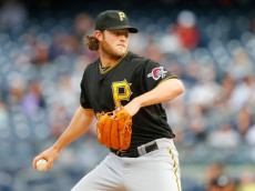 NEW YORK, NY - MAY 18:  Gerrit Cole #45 of the Pittsburgh Pirates delivers a pitch in the first inning against the New York Yankees at Yankee Stadium on May 18, 2014 in the Bronx borough of New York City.  (Photo by Jim McIsaac/Getty Images)