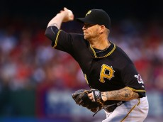 ST. LOUIS, MO - MAY 1: Starter A.J. Burnett #34 of the Pittsburgh Pirates pitches against the St. Louis Cardinals in the first inning at Busch Stadium on May 1, 2015 in St. Louis, Missouri.  (Photo by Dilip Vishwanat/Getty Images)