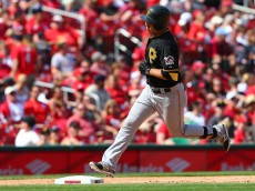 ST. LOUIS, MO - MAY 3: Jung Ho Kang #27 of the Pittsburgh Pirates rounds third base after hitting a solo home run against the St. Louis Cardinals in the ninth inning at Busch Stadium on May 3, 2015 in St. Louis, Missouri.  (Photo by Dilip Vishwanat/Getty Images)