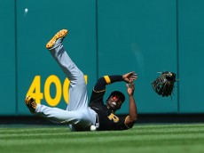 ST. LOUIS, MO - MAY 3: Andrew McCutchen #22 of the Pittsburgh Pirates fails to catch a fly ball against the St. Louis Cardinals in the seventh inning at Busch Stadium on May 3, 2015 in St. Louis, Missouri.  (Photo by Dilip Vishwanat/Getty Images)