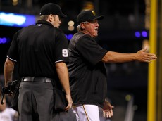 PITTSBURGH, PA - MAY 06:  Clint Hurdle #13 of the Pittsburgh Pirates argues an out call due to the runner being out of the base line with home plate umpire Chris Conroy in the seventh inning during the game against the Cincinnati Reds at PNC Park on May 6, 2015 in Pittsburgh, Pennsylvania.  (Photo by Justin K. Aller/Getty Images)