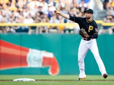PITTSBURGH, PA - MAY 09: Neil Walker #18 of the Pittsburgh Pirates throws to third base for the second out after catching the first of three outs on a triple play in the top of the second inning against the St Louis Cardinals during the game at PNC Park on May 9, 2015 in Pittsburgh, Pennsylvania.  (Photo by Jared Wickerham/Getty Images)