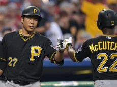 PHILADELPHIA, PA - MAY 11: Jung Ho Kang #27 of the Pittsburgh Pirates congratulates teammate pitching coach Bob McClure #22 after he scored in the third inning at Citizens Bank Park on May 11, 2015 in Philadelphia, Pennsylvania. (Photo by Drew Hallowell/Getty Images)