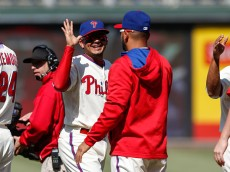 PHILADELPHIA, PA - MAY 14: Freddy Galvis #13 of the Philadelphia Phillies high fives teammates after the game against the Pittsburgh Pirates at Citizens Bank Park on May 14, 2015 in Philadelphia, Pennsylvania. The Phillies won 4-2. (Photo by Brian Garfinkel/Getty Images)  *** Local Caption *** Freddy Galvis