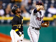 PITTSBURGH, PA - MAY 20: Brian Dozier #2 of the Minnesota Twins reacts following batter interference on an attempted steal by Andrew McCutchen #22 of the Pittsburgh Pirates in the 10th inning during the game at PNC Park on May 20, 2015 in Pittsburgh, Pennsylvania.  (Photo by Jared Wickerham/Getty Images)
