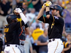 PITTSBURGH, PA - MAY 26:  Neil Walker #18 of the Pittsburgh Pirates celebrates with Josh Harrison #5 after hitting a two run home run in the second inning during the game against the Miami Marlins at PNC Park on May 26, 2015 in Pittsburgh, Pennsylvania.  (Photo by Justin K. Aller/Getty Images)