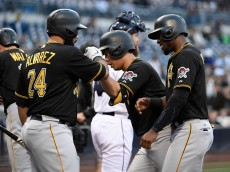 SAN DIEGO, CA - MAY 28:  Jung Ho Kang #27 of the Pittsburgh Pirates is congratulated by Pedro Alvarez #24 and Starling Marte #6, after hitting a three-run home run during the first inning of a baseball game against the San Diego Padres at Petco Park May 28, 2015 in San Diego, California.  (Photo by Denis Poroy/Getty Images)