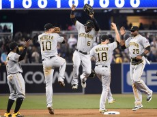SAN DIEGO, CA - MAY 30:  Jordy Mercer #10, Starling Marte #6, Neil Walker #18 and Gregory Polanco #25 of the Pittsburgh Pirates celebrate after beating the San Diego Padres 5-2 in a baseball game at Petco Park May 30, 2015 in San Diego, California.  (Photo by Denis Poroy/Getty Images)