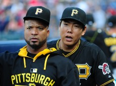 ATLANTA, GA - JUNE 6: Francisco Liriano #47 and Jung Ho Kang #27 of the Pittsburgh Pirates relax in the dugout before the game against the Atlanta Braves at Turner Field on June 6, 2015 in Atlanta, Georgia. (Photo by Scott Cunningham/Getty Images)
