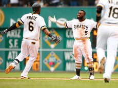 PITTSBURGH, PA - JUNE 14:  Josh Harrison #5 of the Pittsburgh Pirates celebrates his game-winning RBI single in the 11th inning with teammate Starling Marte #6 against the Philadelphia Phillies during the game at PNC Park on June 14, 2015 in Pittsburgh, Pennsylvania.  (Photo by Jared Wickerham/Getty Images)