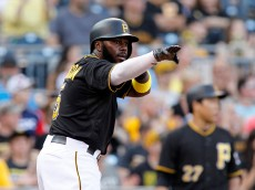 PITTSBURGH, PA - JUNE 15:  Josh Harrison #5 of the Pittsburgh Pirates celebrates after scoring in the first inning during inter-league play against the Chicago White Sox at PNC Park on June 15, 2015 in Pittsburgh, Pennsylvania.  (Photo by Justin K. Aller/Getty Images)