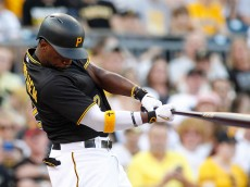 PITTSBURGH, PA - JUNE 15:  Andrew McCutchen #22 of the Pittsburgh Pirates hits an RBI single in the first inning during inter-league play against the Chicago White Sox at PNC Park on June 15, 2015 in Pittsburgh, Pennsylvania.  (Photo by Justin K. Aller/Getty Images)