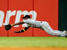 CHICAGO, IL - JUNE 18: Andrew McCutchen #22 of the Pittsburgh Pirates makes a diving catch for an out against the Chicago White Sox during the fourth inning at U.S. Cellular Field on June 18, 2015 in Chicago, Illinois.  (Photo by Jon Durr/Getty Images)