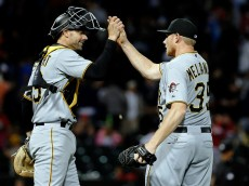 CHICAGO, IL - JUNE 18: Mark Melancon #35 of the Pittsburgh Pirates and Chris Stewart #19 high five after their win over the Chicago White Sox at U.S. Cellular Field on June 18, 2015 in Chicago, Illinois. The Pittsburgh Pirates won 3-2.  (Photo by Jon Durr/Getty Images)