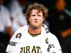 PITTSBURGH, PA - JUNE 24: Gerrit Cole #45 of the Pittsburgh Pirates stands in the dugout in the second inning against the Cincinnati Reds during the game at PNC Park on June 24, 2015 in Pittsburgh, Pennsylvania.  (Photo by Jared Wickerham/Getty Images)