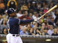 SAN DIEGO, CA - JUNE 27:  Justin Upton #10 of the San Diego Padres hits a two-run home run during the fifth inning of a baseball game against the Arizona Diamondbacks at Petco Park June 27, 2015 in San Diego, California.   (Photo by Denis Poroy/Getty Images)