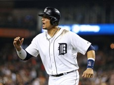 DETROIT, MI - JUNE 30: Victor Martinez #41 of the Detroit Tigers pumps his fist after teammate J.D. Martinez #28 (not in photo) hits a two run home run in the eight inning to tie the interleague game against the Pittsburgh Pirates on June 30, 2015 at Comerica Park in Detroit, Michigan. (Photo by Leon Halip/Getty Images)