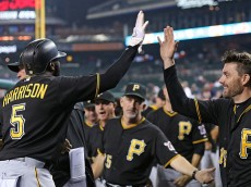 DETROIT, MI - JUNE 30: Josh Harrison #5 of the Pittsburgh Pirates celebrates with Chris Stewart #19 after scoring on the double by Neil Walker #18 (not in photo) in the 14th inning of the interleague game against the Detroit Tigers on June 30, 2015 at Comerica Park in Detroit, Michigan. (Photo by Leon Halip/Getty Images)