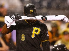 PITTSBURGH, PA - JULY 03:  Starling Marte #6 of the Pittsburgh Pirates wipes the rain from his face in the on deck circle with his bat covered in a Gatorade towel in the seventh inning against the Cleveland Indians during the interleague game at PNC Park on July 3, 2015 in Pittsburgh, Pennsylvania.  (Photo by Jared Wickerham/Getty Images)
