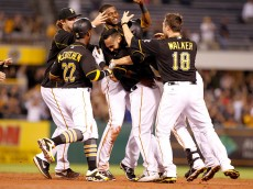 PITTSBURGH, PA - JULY 06:  Pedro Alvarez #24 of the Pittsburgh Pirates celebrates his walk off single with teammates in the ninth inning against the San Diego Padres during the game at PNC Park on July 6, 2015 in Pittsburgh, Pennsylvania.  (Photo by Justin K. Aller/Getty Images)