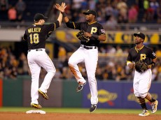 PITTSBURGH, PA - JULY 08:  Gregory Polanco #25 of the Pittsburgh Pirates celebrates with Neil Walker #18 after defeating the San Diego Padres 5-2 at PNC Park on July 8, 2015 in Pittsburgh, Pennsylvania.  (Photo by Justin K. Aller/Getty Images)
