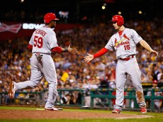 PITTSBURGH, PA - JULY 09: Randal Grichuk #15 of the St Louis Cardinals congratulates teammate Xavier Scruggs #59 after both scored in the fifth inning against the Pittsburgh Pirates during the game at PNC Park on July 9, 2015 in Pittsburgh, Pennsylvania.  (Photo by Jared Wickerham/Getty Images)