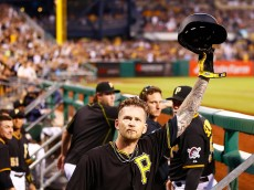 PITTSBURGH, PA - JULY 11: A.J. Burnett #34 of the Pittsburgh Pirates salutes the crowd from the dugout while receiving a standing ovation following his solo home run in the 5th inning against the St Louis Cardinals during the game at PNC Park on July 11, 2015 in Pittsburgh, Pennsylvania.  (Photo by Jared Wickerham/Getty Images)