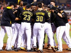 PITTSBURGH, PA - JULY 11:  Andrew McCutchen #22 of the Pittsburgh Pirates celebrates with teammates at home plate after hitting the game-winning two run home run in the 14th inning against the St Louis Cardinals during the game at PNC Park on July 11, 2015 in Pittsburgh, Pennsylvania.  (Photo by Jared Wickerham/Getty Images)