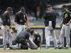 MILWAUKEE, WI - JULY 19: Jordy Mercer #10 of the Pittsburgh Pirates holds his leg after a collision with Carlos Gomez of the Milwaukee Brewers during the second inning at Miller Park on July 19, 2015 in Milwaukee, Wisconsin. (Photo by Mike McGinnis/Getty Images)  *** Local Caption *** Jordy Mercer