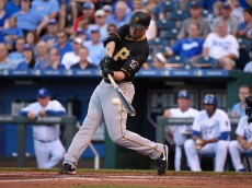 KANSAS CITY, MO - JULY 20:  Travis Ishikawa #30 of the Pittsburgh Pirates hits a two-run double in the second inning against the Kansas City Royals at Kauffman Stadium on July 20, 2015 in Kansas City, Missouri. (Photo by Ed Zurga/Getty Images)