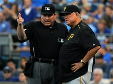 KANSAS CITY, MO - JULY 21:  Umpire Gerry Davis talks with manager Clint Hurdle #13 of the Pittsburgh Pirates after Starling Marte's  home run was reviewed and overturned to a ground-rule double in the second inning against the Kansas City Royals at Kauffman Stadium on July 21, 2015 in Kansas City, Missouri. (Photo by Ed Zurga/Getty Images)