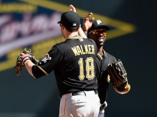MINNEAPOLIS, MN - JULY 29: Neil Walker #18 and Andrew McCutchen #22 of the Pittsburgh Pirates celebrate a win of the game against the Minnesota Twins on July 29, 2015 at Target Field in Minneapolis, Minnesota. The Pirates defeated the Twins 10-4. (Photo by Hannah Foslien/Getty Images)