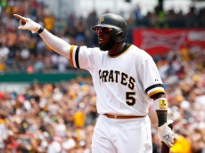 PITTSBURGH, PA - JULY 05:  Josh Harrison #5 of the Pittsburgh Pirates celebrates after scoring in the fifth inning against the Cleveland Indians during the game at PNC Park on July 5, 2015 in Pittsburgh, Pennsylvania.  (Photo by Jared Wickerham/Getty Images)