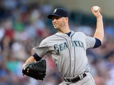 MINNEAPOLIS, MN - JULY 30: J.A. Happ #33 of the Seattle Mariners delivers a pitch against the Minnesota Twins during the first inning of the game on July 30, 2015 at Target Field in Minneapolis, Minnesota. (Photo by Hannah Foslien/Getty Images)