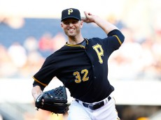 PITTSBURGH, PA - AUGUST 04: J.A. Happ #32 of the Pittsburgh Pirates pitches in the first inning against the Chicago Cubs during the game at PNC Park on August 4, 2015 in Pittsburgh, Pennsylvania.  (Photo by Jared Wickerham/Getty Images)