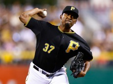 PITTSBURGH, PA - AUGUST 04: Arquimedes Caminero #37 of the Pittsburgh Pirates pitches in the 8th inning against the Chicago Cubs during the game at PNC Park on August 4, 2015 in Pittsburgh, Pennsylvania.  (Photo by Jared Wickerham/Getty Images)