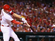 ST. LOUIS, MO - AUGUST 11: Stephen Piscotty #55 of the St. Louis Cardinals hits an RBI single against the Pittsburgh Pirates in the fifth inning at Busch Stadium on August 11, 2015 in St. Louis, Missouri.  (Photo by Dilip Vishwanat/Getty Images)