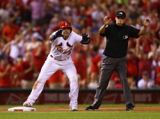 ST. LOUIS, MO - AUGUST 12: Yadier Molina #4 of the St. Louis Cardinals acknowledges the dugout after hitting an RBI triple against the Pittsburgh Pirates as umpire Adam Hamari #78 signals Molina safe in the sixth inning at Busch Stadium on August 12, 2015 in St. Louis, Missouri.  (Photo by Dilip Vishwanat/Getty Images)