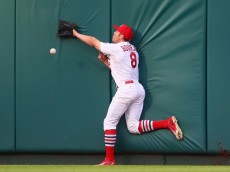 ST. LOUIS, MO - AUGUST 13: Peter Bourjos #8 of the St. Louis Cardinals fails to catch a fly ball against the Pittsburgh Pirates in the first inning at Busch Stadium on August 13, 2015 in St. Louis, Missouri.  (Photo by Dilip Vishwanat/Getty Images)
