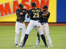 NEW YORK, NY - AUGUST 14:  Starling Marte #6 (L), Gregory Polanco #25 and Andrew McCutchen #22 of the Pittsburgh Pirates celebrate after defeating the New York Mets at Citi Field on August 14, 2015 in the Flushing neighborhood of the Queens borough of New York City.  (Photo by Jim McIsaac/Getty Images)