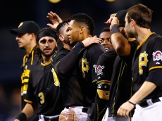 PITTSBURGH, PA - AUGUST 18:  Pedro Florimon #23 of the Pittsburgh Pirates is congratulated by teammate Francisco Cervelli #29 after hitting the game winning RBI in the 15th inning against the Arizona Diamondbacks during the game at PNC Park on August 18, 2015 in Pittsburgh, Pennsylvania.  (Photo by Jared Wickerham/Getty Images)