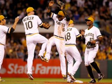 PITTSBURGH, PA - AUGUST 23:  Starling Marte #6 of the Pittsburgh Pirates celebrates with teammates after defeating the San Francisco Giants 5-2 at PNC Park on August 23, 2015 in Pittsburgh, Pennsylvania.  (Photo by Justin K. Aller/Getty Images)