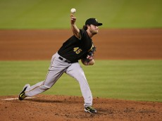 MIAMI, FL - AUGUST 27:  Gerrit Cole #45 of the Pittsburgh Pirates pitches during the fourth inning of the game against the Miami Marlins at Marlins Park on August 27, 2015 in Miami, Florida.  (Photo by Rob Foldy/Getty Images)