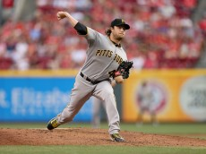CINCINNATI, OH - AUGUST 01:  Gerrit Cole #45  of the Pittsburgh Pirates throws a pitch against the Cincinnati Reds at Great American Ball Park on August 1, 2015 in Cincinnati, Ohio.  (Photo by Andy Lyons/Getty Images)