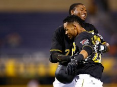 PITTSBURGH, PA - AUGUST 18: Pedro Florimon #23 of the Pittsburgh Pirates is congratulated by teammate Gregory Polanco #25 after hitting the game winning RBI in the 15th inning against the Arizona Diamondbacks during the game at PNC Park on August 18, 2015 in Pittsburgh, Pennsylvania.  (Photo by Jared Wickerham/Getty Images)